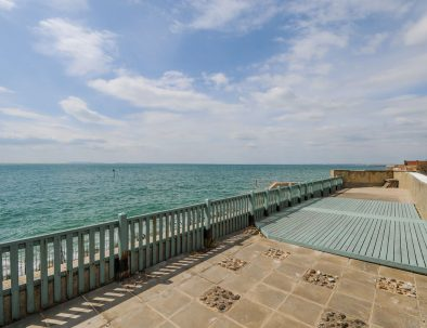 Selsey Beach House view of the beach from the garden patio.